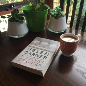 Book with cup of tea and plants