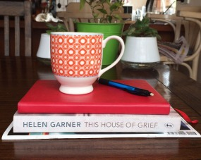Stack of books and cup of tea